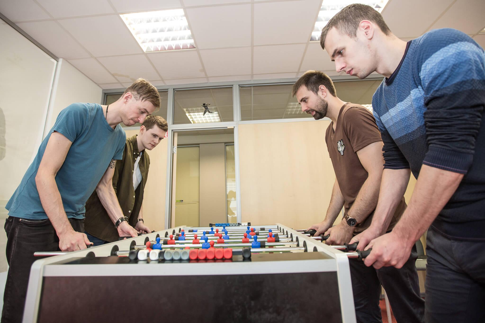 E-Bros team playing foosball